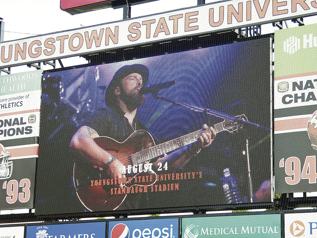 Tribune Chronicle / Andy Gray  The scoreboard at Stambaugh Stadium at YSU was used to reveal the headline act at the inaugural Y Live concert there. The Zac Brown Band, a country music act, has won three Grammy Awards and has released six studio albums.