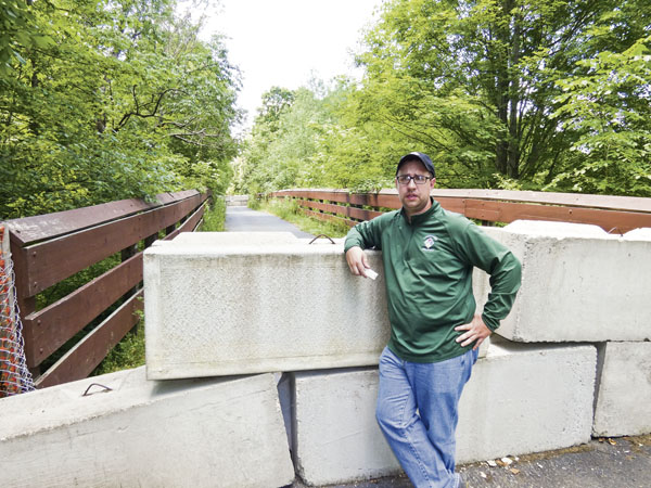 Zachary Svette, operations manager for Trumbull County MetroParks, talks about the re-opening of the Western Reserve Greenway in Bristol.