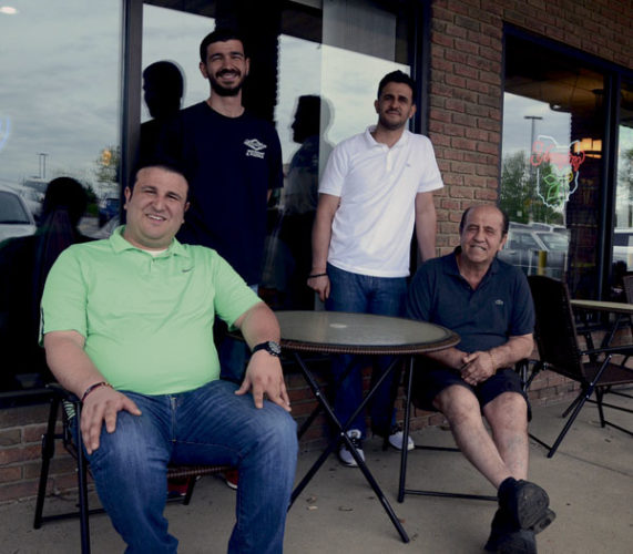 042817...R VASILIO 1...Cortland...04-28-17...Brothers from left, George Tambures, Kris Tambures and Paul Tambures with father Chris Tambures outside their restaurant...by R. Michael Semple