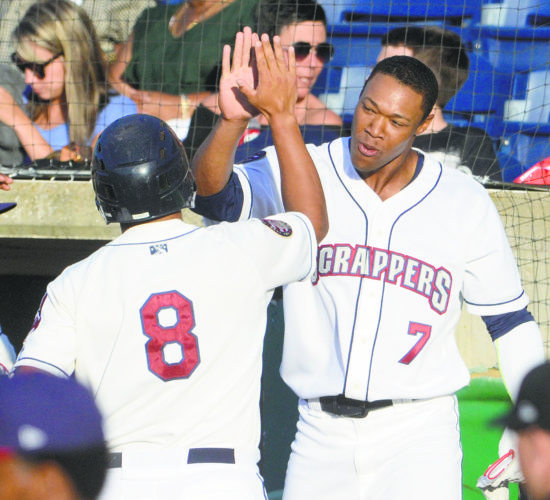 Tribune Chronicle / R. Michael Semple Mahoning Valley's Ulysses Cantu (8) high-fives teammate Will Benson after Cantu scored during the second inning of the Scrappers' home opener Wednesday against Auburn. The Doubledays beat the Scrappers, 3-2.