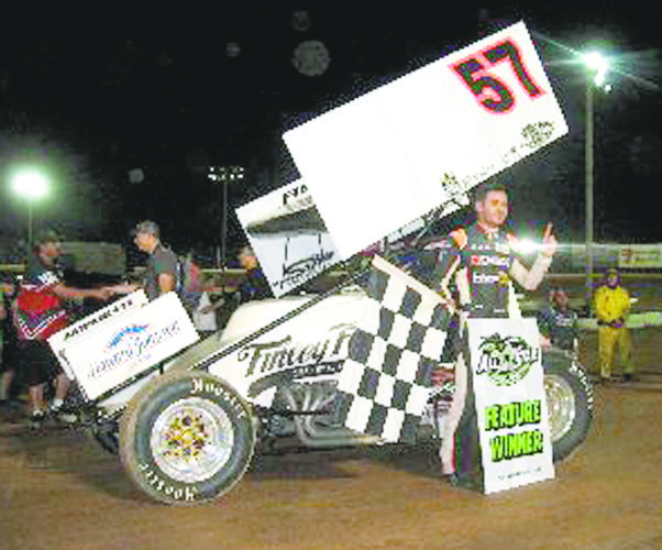 Special to Tribune Chronicle / Ken Marquette NASCAR star and current Monster Energy Cup points leader Kyle Larson poses for a photo after winning Sharon Speedway's Ohio Speedweek race Tuesday night. Larson beat a strong All-Star Circuit of Champions field of 48, including local favorite Dave Blaney.