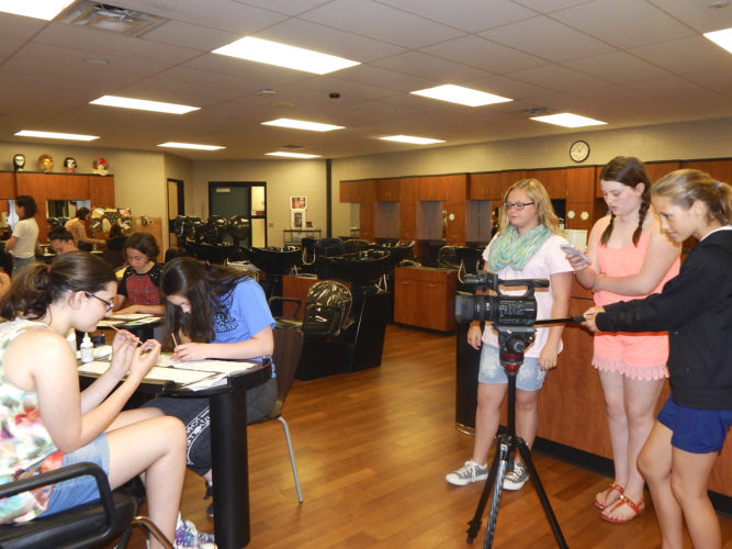 Tribune Chronicle photos  / Bob Coupland Hannah Patchin, 14, of Champion, and Teagan Pierce, 13, of Lakeview, both at left, are in cosmetology class while by videotaped by multimedia students Olivia Jackson, 13, home-schooled, Avery Jones, 12, of Lakeview, and Reagan Lew, 13, of Lakeview during a summer enrichment program for seventh- to ninth-graders at Trumbull Career and Technical Center.
