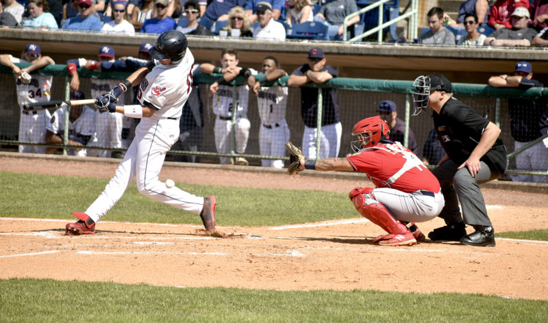 Tribune Chronicle / Eric Murray Mahoning Valley's Nolan Jones, left, swings and misses at a pitch during Sunday's game against State College. The Scrappers lost to the Spikes 9-0 at Eastwood Field. Also pictured is State College catcher Josh Lopez, center, and home plate umpire John Boccio.