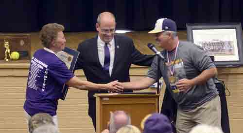 Tribune Chronicle / R. Michael Semple Champion High School softball head coach Cheryl Weaver, left, and Champion High baseball head coach Rick Yauger, right, congratulate each other on their teams winning state championships as state Rep. Michael O'Brien, center, introduces them at the celebration rally Monday at Champion High School.