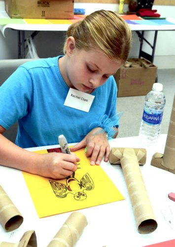 Tribune Chronicle / R. Michael Semple Rachel Clark, 10, of Cortland, draws her design for a sculpture of a northwest American Indian totem pole, which she planned to make while attending the Butler Summer Art Camp Tuesday at the Howland branch of the Butler Institute of American Art.