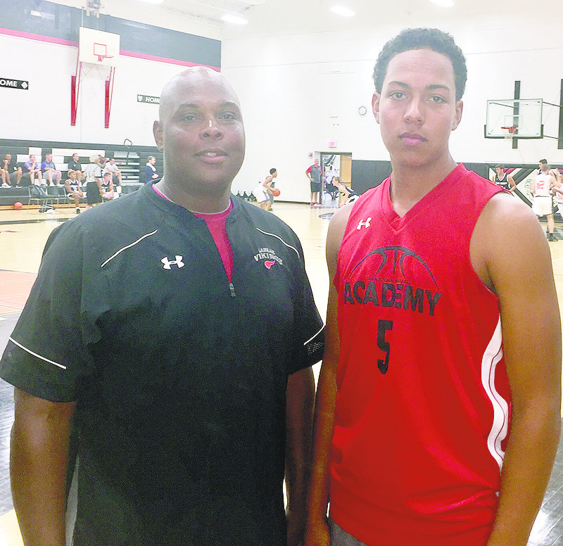 Tribune Chronicle / John Vargo Several LaBrae High School basketball players are improving their games playing on the AAU circuit. Among the Vikings playing in a tournament in the Columbus area this past weekend is Tyler Stephens, 5, pictured with his father, Tony Stephens.