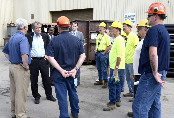 Tribune Chronicle / R. Michael Semple U.S. Sen. Sherrod Brown, D-Ohio, second from left, visits Wheatland Tube on Deitz Road in Warren Monday with employees about his push to expand the Buy America Act rules.