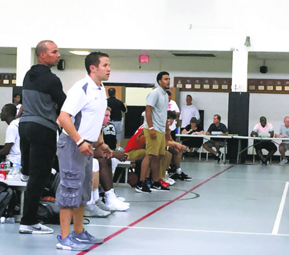Tribune Chronicle / John Vargo Steve Vega, an Avon native, coaches his TNBA team during Friday's Nike Summer Championship in Columbus. Vega is the co-director of the tournament.