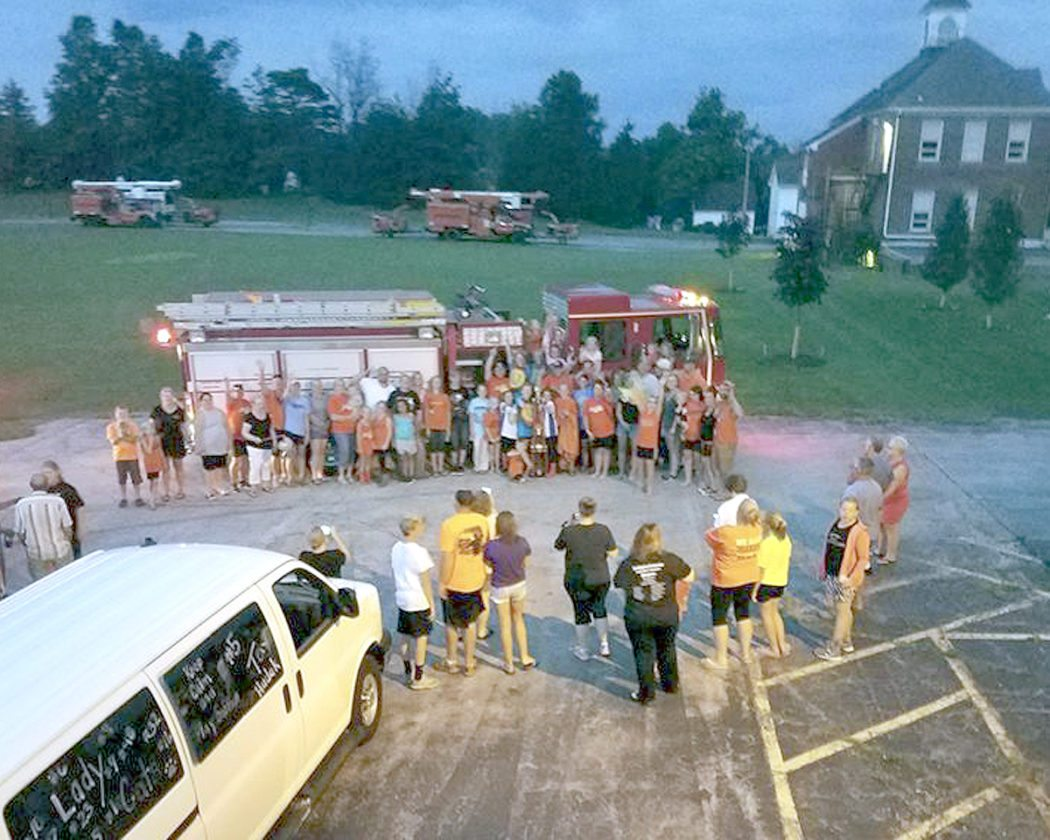 Members of the Southington 9-10 year-old girls softball team are greeted by residents of the community after the Wildcats won the Ohio Girls Softball Organization state title in late July. It was the first OGSOstate title for a Southington team.