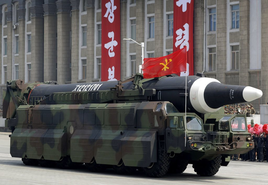 "FILE - In this April 15, 2017, file photo, a missile that analysts believe could be the North Korean Hwasong-12 is paraded across Kim Il Sung Square in Pyongyang. The country's official Korean Central News Agency said the missile fired Sunday, May 14, 2017, was a Hwasong-12 ""capable of carrying a large-size heavy nuclear warhead."" North Korea said Wednesday that it was examining operational plans for attacking Guam, an angry reaction to U.N. punishment for recent North Korean intercontinental ballistic missile tests and a U.S. suggestion about preparations for possible preventive attacks to stop the North's nuclear weapons program. (AP Photo/Wong Maye-E, File)"