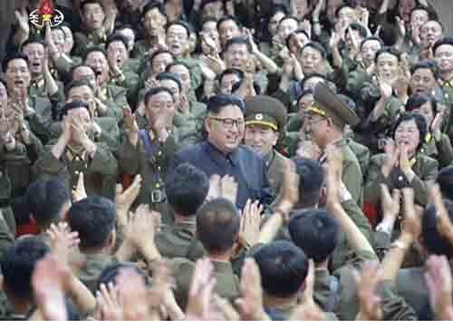 """AP This image made from video of a still image broadcast in a news bulletin Tuesday by North Korea's KRT shows North Korean leader Kim Jong Un applauded at a performance in Pyongyang. North Korea said leader Kim Jong Un was briefed on his military's plans to launch missiles in waters near Guam days after the Korean People's Army announced its preparing to create """"enveloping fire"""" near the U.S. military hub in the Pacific. Independent journalists were not given access to cover the event depicted in this photo."""