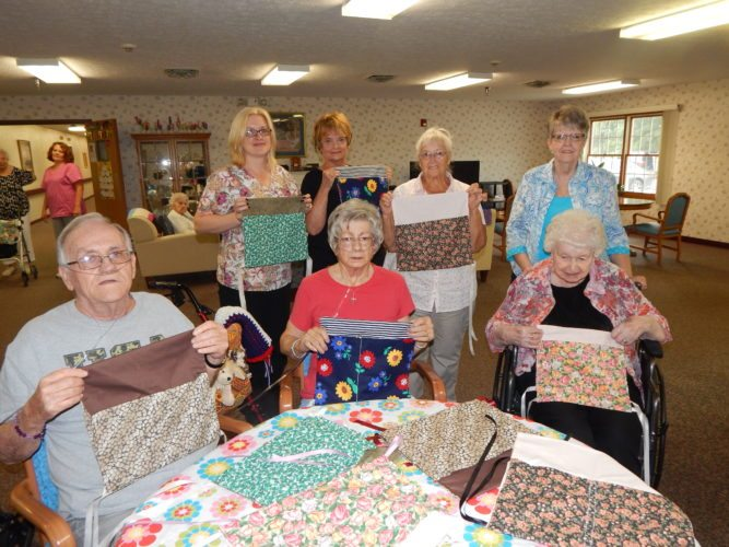 Tribune Chronicle/ Bob Coupland Members of the Lordstown SCOPE Center have made walker bags for residents of the Laurie Ann Nursing Home in Newton Falls to carry various items. Front row, from left, are nursing home residents Jim Shook, Mary Ann Tomlin and Betty Cattot. Standing, from left, are Selina Pratt, activities director; Jeanne Phillip and Anna Collins of SCOPE and Marge Haley, director of Lordstown SCOPE