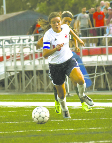 Tribune Chronicle / John Vargo Bethany Rasile of Niles takes the ball downfield Friday night during the Red Dragons' 3-0 victory over West Branch at Bo Rein Stadium. It was the opening day of the high school soccer season in Ohio.