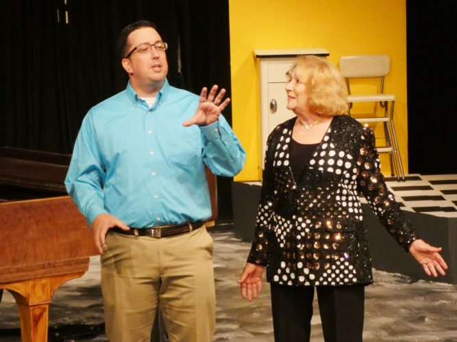 "Tribune Chronicle / Andy Gray From left, Brett Bunker, current president of the Trumbull New Theatre board, and Emily Webster Love, who has been involved with the community theater for more than 50 years, sing ""Welcome to the Theater"" to open TNT 60th anniversary celebration for the opening of its performance space in Niles."
