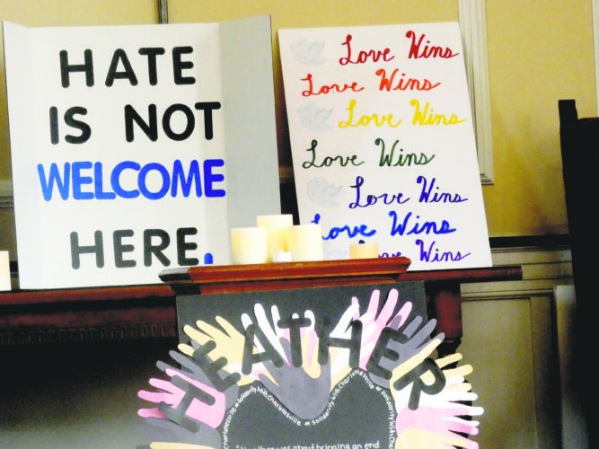 "Tribune Chronicle / Guy Vogrin Some of the signs opposing hate were spread across the front of the Unitarian church in Youngstown Sunday afternoon during the ""Vigil Against Hate"" held by Valley Voices United for Change. The group held the event as part of a day of solidarity to repudiate the violent protests that resulted in three deaths last weekend in Charlottesville, Va."