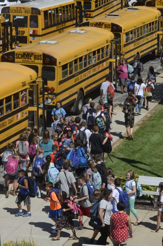 Tribune Chronicle / R. Michael Semple  Lakeview Middle School students board buses at the end of the school day last week.
