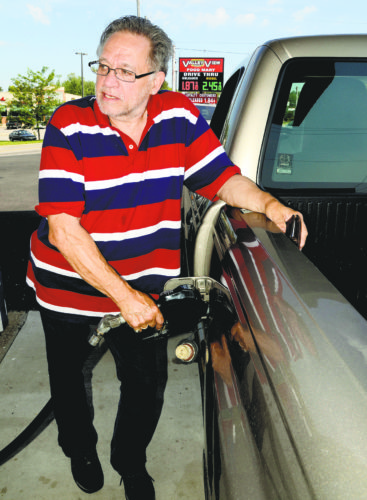 Tribune Chronicle / R. Michael Semple Lenny Reynolds of Warren fills his truck tank with discounted gasoline at Valley View Food Mart during a Monday morning gas war in Cortland.