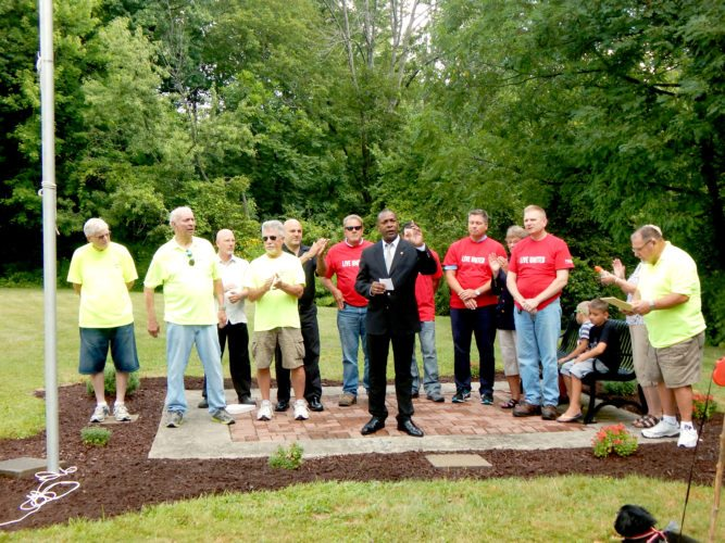 Tribune Chronicle / Bob Coupland Mayor Doug Franklin, city officials and members of the Northwest Neighborhood Association attend a dedication ceremony for Warren Memorial Park off Tod Avenue. Volunteers with United Way of Trumbull County helped with beautifying the park with landscaping and cleanup as part of an annual summer work day.