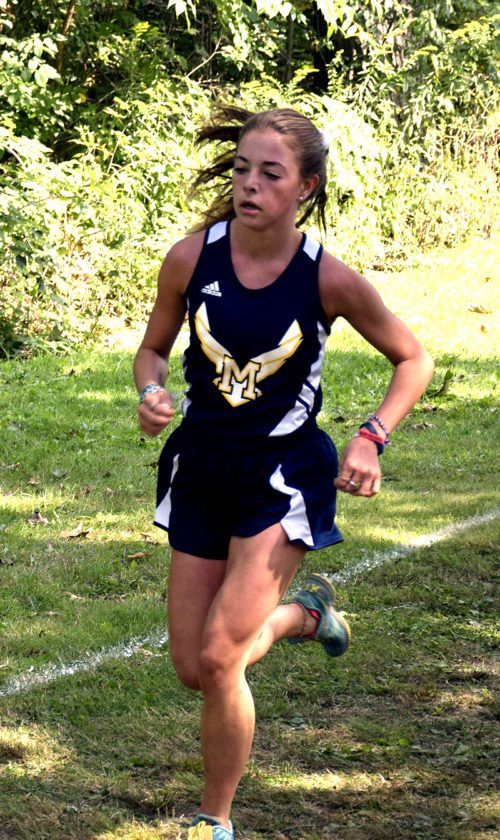 Tribune Chronicle / John Vargo McDonald's Anna Guerra runs during Saturday's Billy Goat Challenge. She finished first to lead the Blue Devils to the Billy Goat Challenge girls varsity title. Guerra is one of many sophomores to lead this cross country team.