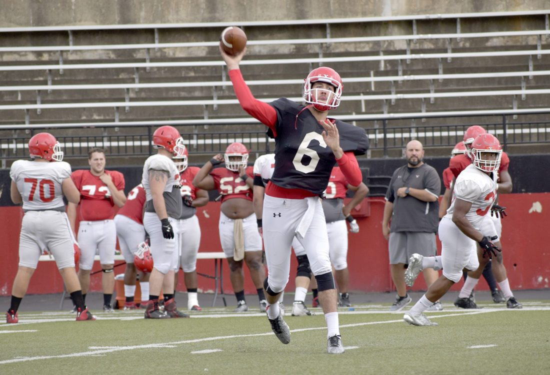Youngstown State quarterback Hunter Wells throws a pass during practice Tuesday at Stambaugh Stadium in Youngstown. After five weeks of hitting their teammates, the Penguins are ready to make contact with an opponent. They get that chance Saturday in the season opener at Pitt.