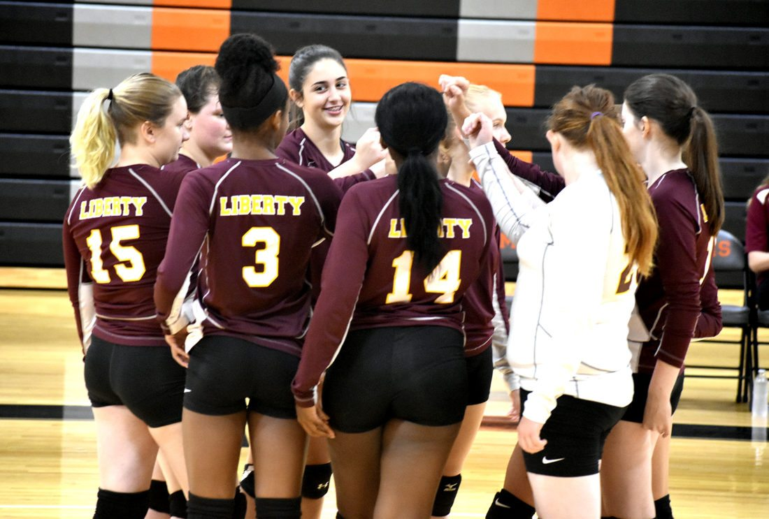 Tribune Chronicle / Eric Murray The Liberty volleyball team prepares to break the huddle after a break in their loss Wednesday at Mineral Ridge.