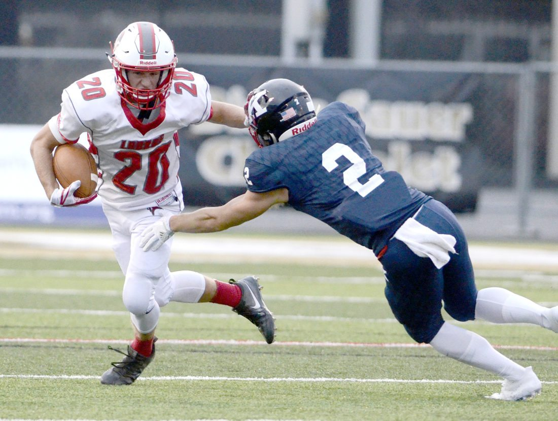 090117...R LABRAE 5...Warren...09-01-17...LaBrae #20 Benton Tennant rushes for yardage as JFK;s #2 Thomas Yanovich goes for the tackle during 1st half action...by R. Michael Semple