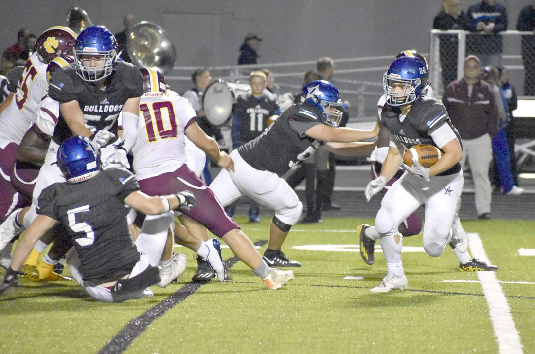 Tribune Chronicle / Joe Simon Lakeview's Tony Crish, right, runs the ball against the Liberty defense during the second half of the Bulldogs' 30-20 victory over the Leopards.