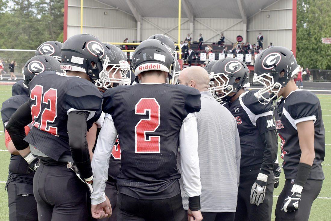Tribune Chronicle / Eric Murray Girard's team huddles prior to Friday's game against Hubbard at Arrowhead Stadium in Girard.