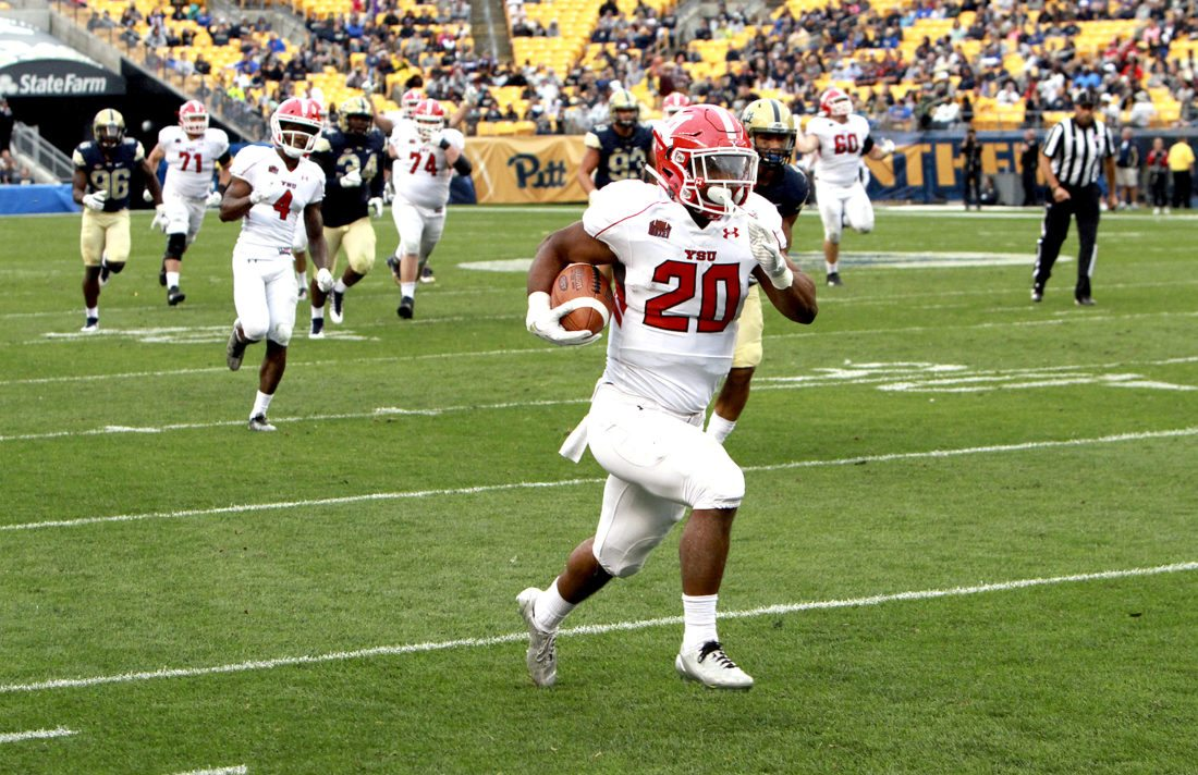 Special to Tribune Chronicle / Youngstown State University, Ron Stevens YSU receiver Christian Turner takes off toward the end zone after catching one of his two fourth-quarter touchdown receptions against Pitt, helping the Penguins rally from a 21-0 halftime deficit.