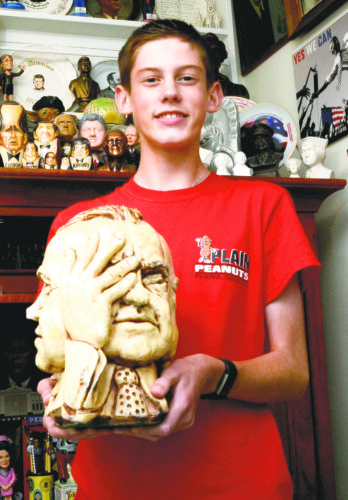 Tribune Chronicle / R. Michael Semple Mason St. Clair, 15, of Niles holds a bust of President Richard Nixon, which is part of his presidential memorabilia collection.