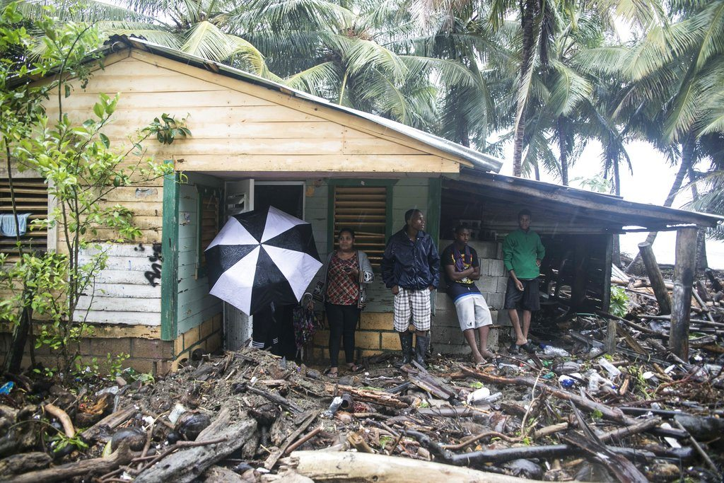 A home is surrounded by debris brought in by Hurricane Irma in Nagua, Dominican Republic, Thursday, Sept. 7, 2017. Irma cut a path of devastation across the northern Caribbean, leaving thousands homeless after destroying buildings and uprooting trees. Irma flooded parts of the Dominican Republic when it roared by Thursday, just off the northern coast of the island it shares with Haiti. (AP Photo/Tatiana Fernandez)