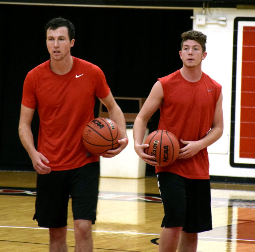 Tribune Chronicle / John Vargo YSU's Dan Ritter, left, and Justin Bofenkamp, right, are running drills during Thursday's workout at Youngstown State Universty. Ritter, a South Range graduate, and Bofenkamp, a John F. Kennedy graduate, are part of the seven walk-ons in YSU's men's basketball program.