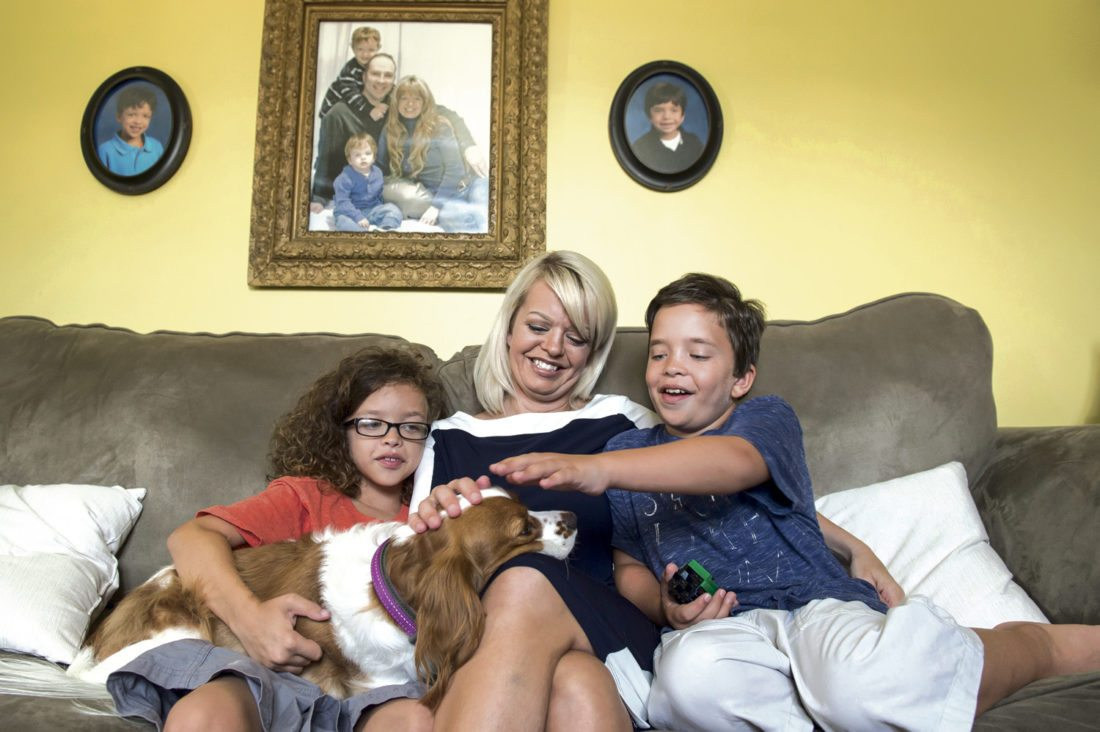 AP photos / Dan Rainville, The Evening Sun  Anna Corbin sits between her two sons, Jackson, left, and Henry, as they play with their dog, Eloise, inside their Hanover, Pa., home. Henry, 9, and Jackson, 11, both have Noonan syndrome, a genetic disorder that affects various systems of the body.