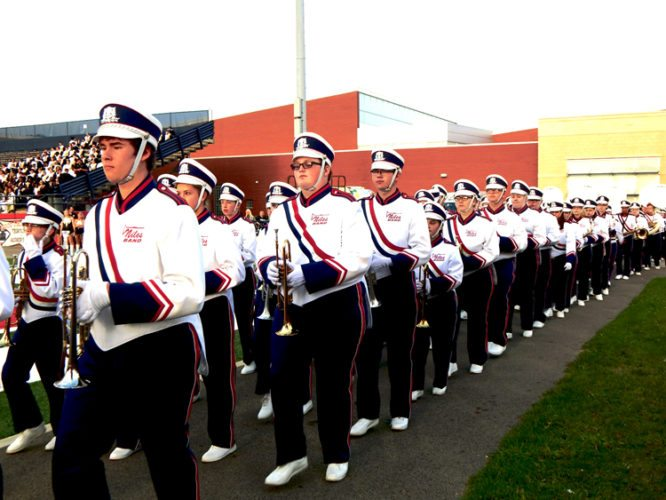 Tribune Chronicle  / Bob Coupland Members of the Niles McKinley High School band march onto the field Tuesday for the annual Band Night. Bands from Girard, Howland, McDonald, Mineral Ridge, Warren Harding and Niles performed.