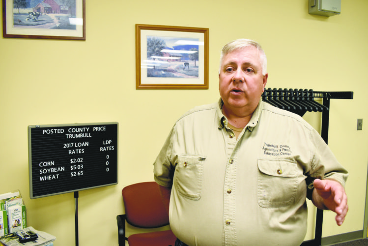 Tribune Chronicle / Renee Fox Ed Agler, volunteer director of the Trumbull County Agriculture and Family Education Center in Cortland, explains how the center helps local farmers cooperate with the many federal regulations imposed on the industry.