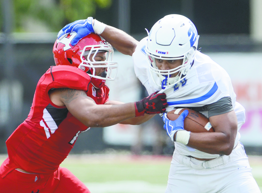091617...R CCSU/YSU 2...Youngstown...09-16-17...YSU #7 Bryce Gibson stops CCSU rusher # 20 Drew Jean-Duillaume during 1st half acdtion...by R. Michael Semple