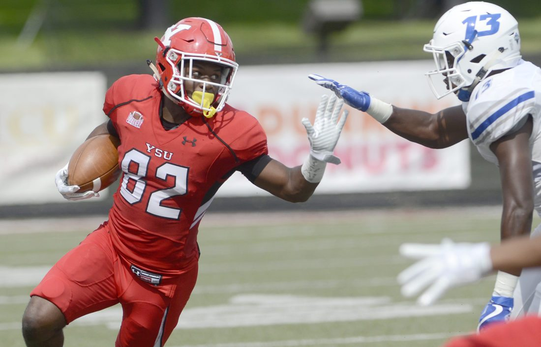 091617...R CCSU/YSU 5...Youngstown...09-16-17...YSU # 82 Samual St. Surin makes a reception and is pursued by CCSU #13 Najae Brown during 1st half action...by R. Michael Semple