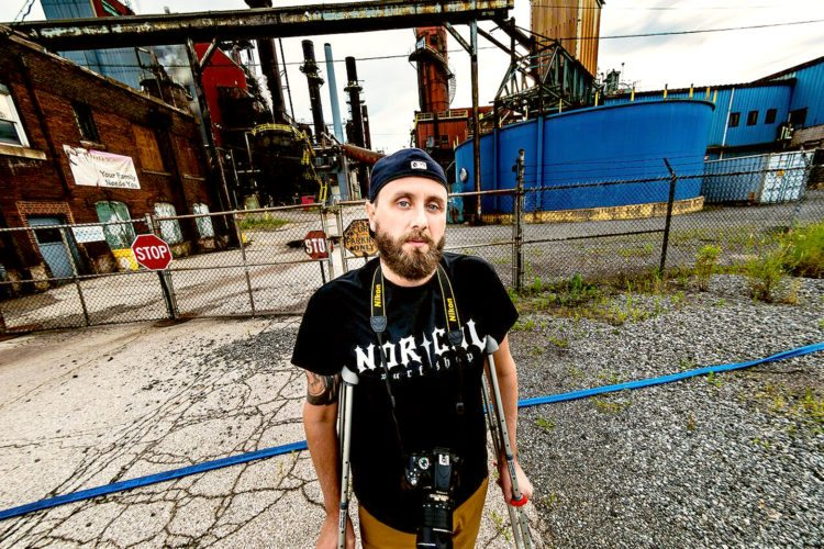 "Special to the Tribune Chronicle / Natalie Mancino  Paul Grilli stands outside the former RG Steel in Warren. Grilli created the website ""The Rust Jungle"" to highlight and preserve what he can of the Mahoning Valley's steel industry history."