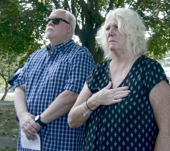 Marc Wortman, left, and his sister, Lori Wellington, both of Stillman Valley, Ill., honor their uncle, Ronald L. Mayer, during a ceremony Monday at Newton Falls Memorial Park in Newton Falls.  Mayer died in the C-119 plane crash in 1953. Mayer, a second lieutenant in the U.S. Air Force, was on the plane as crew chief when it crashed because of an electrical fire. He and another crew member died.