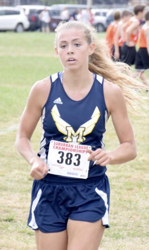 Tribune Chronicle / John Vargo Malina Mitchell of McDonald was the girls individual winner Tuesday in the Suburban League cross country championships at Canfield Fairgrounds.