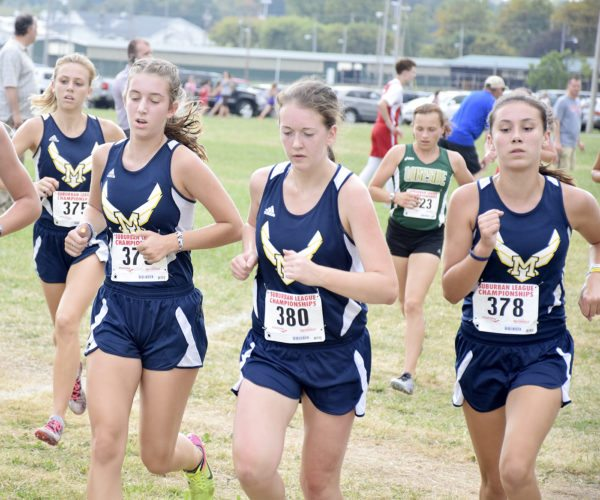 Tribune Chronicle / John Vargo McDonald cross country teammates (from left) Claire Hoffman, Sophie Klase, Alyssa Lynch and Grace Kawecki run in Tuesday's Suburban League Championship. The McDonald girls repeated as team champions.
