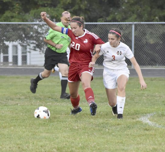 Niles' Isabella Reigle (20) and Howland's Ashley Chambers battle for possession during the first half of their matchup Wednesday. Howland held on for a 1-0 victory between the rivals.