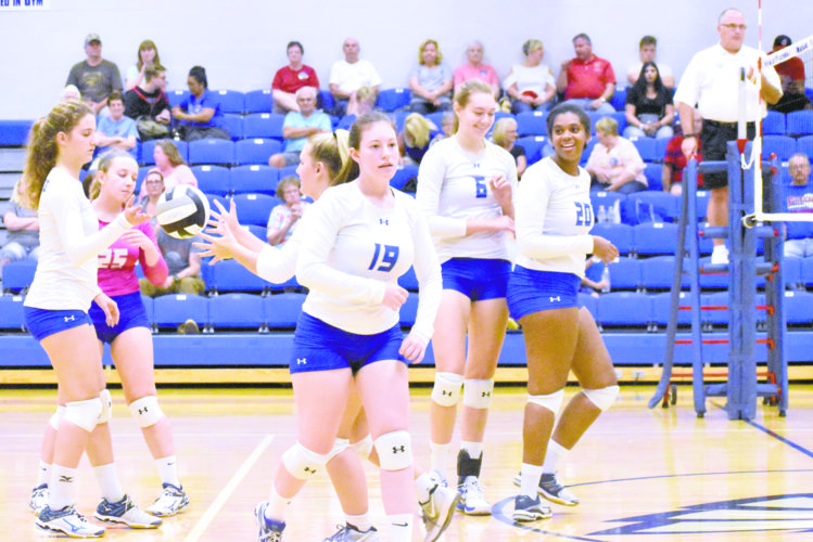 Tribune Chronicle / Marc Weems Hubbard players, including Cailey Tingler (19), Adria Powell (6) and Nya Thornton, celebrate a victory over Austintown Fitch on Thursday in Hubbard. The Eagles beat the Falcons in straight sets.