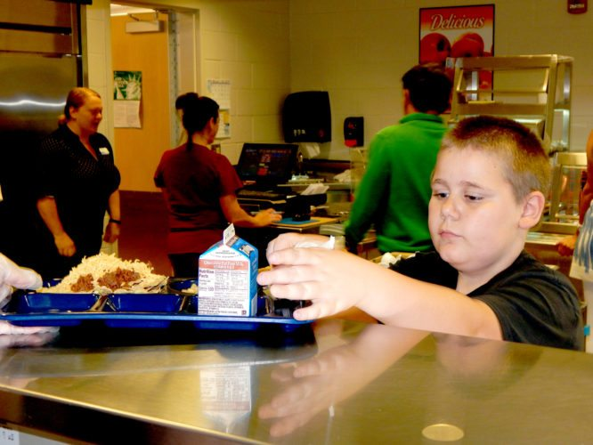 Tribune Chronicle / Bob Coupland Niles Intermediate School fifth-grader Chase Humyady, 10, gets his free lunch Wednesday at the school. The Niles City School District is providing free breakfasts and lunches to every student in grades kindergarten through fifth.