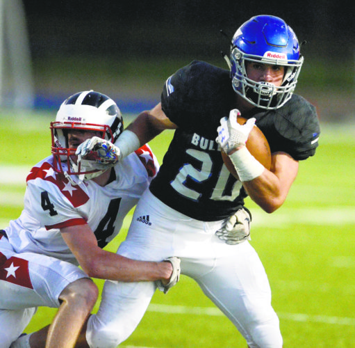 Tribune Chronicle / R. Michael Semple Lakeview's Tony Crish (20) fights for yardage as Niles' Trent Johnson goes for a tackle during their matchup Friday at Don Richards Stadium. Crish scored three times in the Bulldogs' 41-16 victory.
