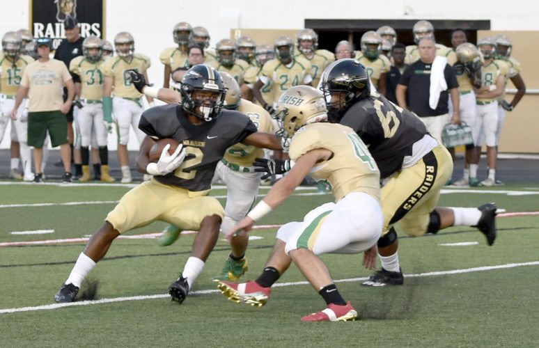 Tribune Chronicle / Doug Chapin Warren G. Harding's Kayron Adams (2) tries to avoid the tackle of Ursuline's Mario Fusillo while Jowan Poole follows the play.