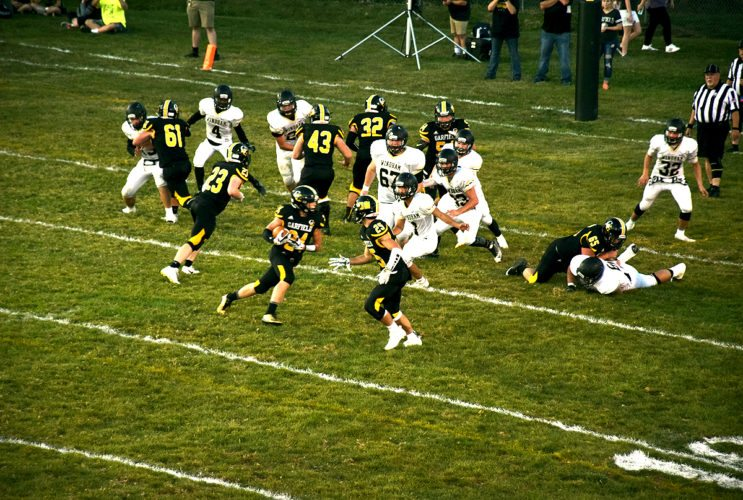 Tribune Chronicle / John Vargo Garfield's Ryan Brown runs a sweep for a 3-yard score in the first quarter of Friday's game in Garrettsville. The G-Men rallied from a 14-point deficit in the fourth quarter to rally over arch-rival Windham, 29-28.
