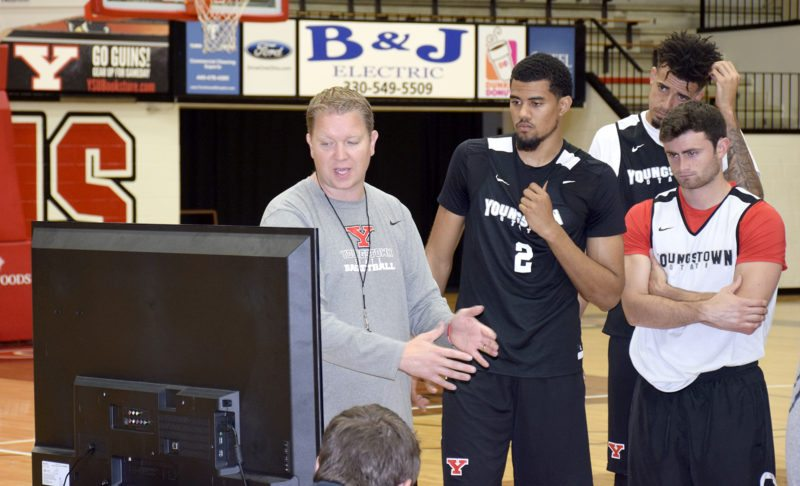 Tribune Chronicle / John Vargo YSU men's basketball coach Jerrod Calhoun breaks down some video during a recent practice. The men's basketball team starts practice Sept. 30 in preparation for the team's first game Nov. 11 at Akron against Kent State.