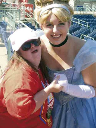 Mary Mort, left, of Lisbon, poses with Cinderella, also known as Allison Grusha of Mineral Ridge, prior to the Buddy Walk at Eastwood Field Sunday. Grusha works for Castle on the Cloud of Newton Falls. Tribune Chronicle / Guy Vogrin