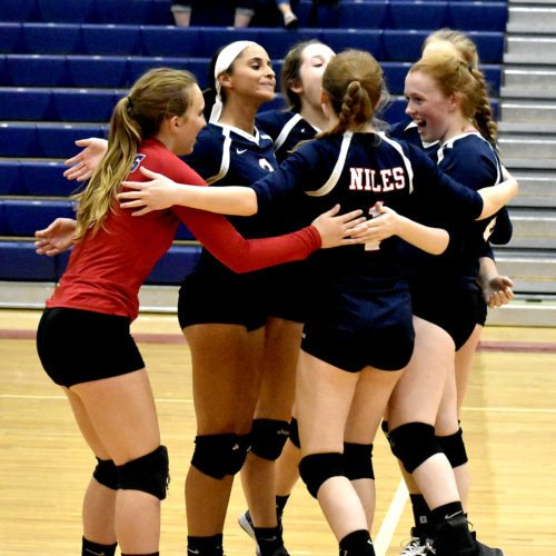 Tribune Chronicle / Marc Weems Niles' volleyball team celebrates during Monday's victory over LaBrae in Niles.